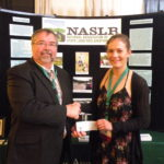 Picture of Sam Faith presenting Scholarship Winner Florence Miller a check from NASLR.