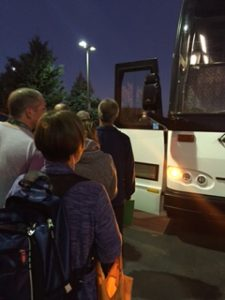 Picture of attendees boarding buses.